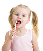 Cute child girl brushing teeth isolated on white background — Fotografia Stock
