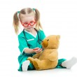Child girl dressed as doctor playing with toy — Stock Photo #23758645