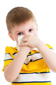 Kid cleaning nose with tissue isolated on white — Stock Photo