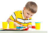 Happy kid with colorful clay toy — Stock Photo