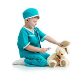 Boy kid playing doctor with toy — Stock Photo