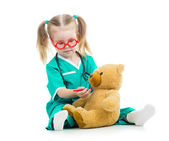 Child girl dressed as doctor playing with toy — Stock Photo