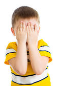 Kid crying or playing with hiding face isolated — Stock Photo