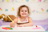 Little smiling child drawing with felt-tip pen — Stock Photo
