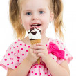 Joyful child girl eating ice cream in studio isolated — 图库照片