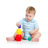 Baby boy playing with toys, isolated over white — Stock Photo