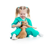 Doctor girl playing and measuring cat temperature — Stock Photo