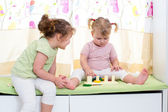 Children sisters play together indoors — Stock Photo