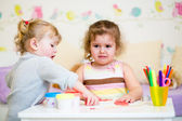 Kid offended by her younger sister — Stock Photo