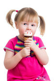 Child girl eating ice cream in studio isolated — Stock Photo
