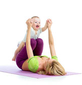 Mother with baby doing gymnastics and fitness exercises — Stock Photo