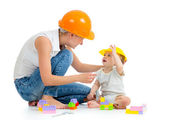 Kid and mother play with building blocks toy — Stok fotoğraf