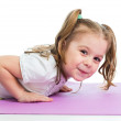 Kid girl pushing up — Stockfoto