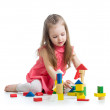 Child girl playing with block toys over white background — Stock Photo #25047001