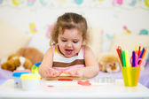 Little kid playing with colorful clay — Stock Photo