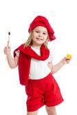 Klein meisje in kunstenaar kostuum geïsoleerd — Stockfoto