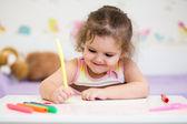Child girl with felt-tip pen — Stock Photo