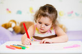 Child writing with felt-tip pen — Stock Photo