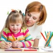 Mother and daughter pencil together — Stock Photo