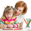 Mother and daughter pencil together — Stockfoto