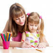 Mother and her child girl pencil together — Stock Photo #25752115