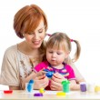 Mother and daughter play with dough — Stock Photo