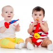 Babies girls play musical toy — Stock Photo