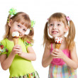 Stock Photo: Happy girls eating ice cream in studio isolated