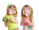 Happy girls eating ice cream in studio isolated — Stock Photo