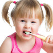 Stock Photo: Kid girl brushing teeth isolated