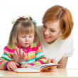 Stock Photo: Mother reading a book child