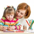 Mother and kid girl draw together — 图库照片