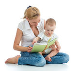 Mother reading a book to her baby boy — Stockfoto