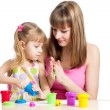 Stock Photo: Kid girl and mother playing colorful clay toy