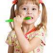 Child girl brushing teeth isolated on white background — Stock Photo