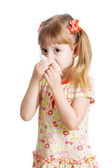 Girl crying and cleaning nose with tissue isolated on white — Stock Photo