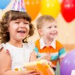 Happy child girl with colorful balloons and gift — Foto Stock