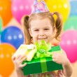 Smiling child girl with gidts on birthday party — 图库照片