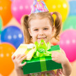 Smiling child girl with gidts on birthday party — Stockfoto