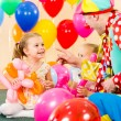 Happy kids and clown on birthday party — Stock Photo