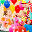 Happy kids and clown on birthday party — Stock Photo #26970631