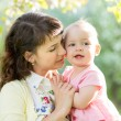 Cute mother with baby girl outdoors — Stock Photo