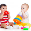 Stock Photo: Babies girls playing toy together