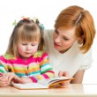 Mother reading a book kid girl — Stock Photo