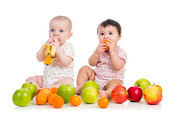 Babies eating fruits — Stock Photo