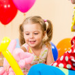 Happy kid girl and clown on birthday party — Stock Photo