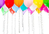 Color balloons with streamers on birthday party — Stock Photo