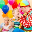 Happy kid boy and clown on birthday party — Stock Photo #27209083