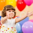 Smiling child girl with balloons on birthday party — Stock Photo