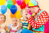 Happy kid boy and clown on birthday party — Stock Photo